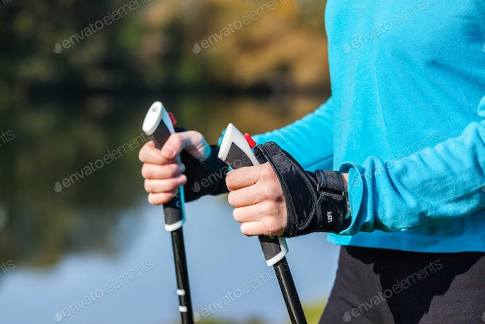 Closeup of woman's hand with nordic walking poles