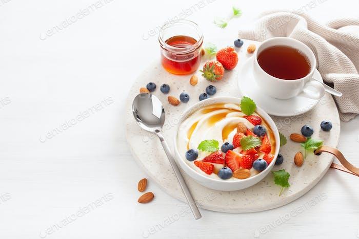 yogurt with strawberry blueberry honey almond for breakfast