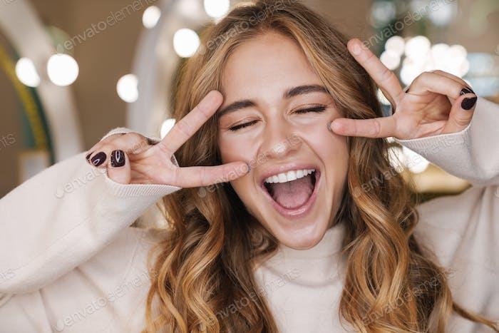 Optimistic cute blonde girl in beauty salon