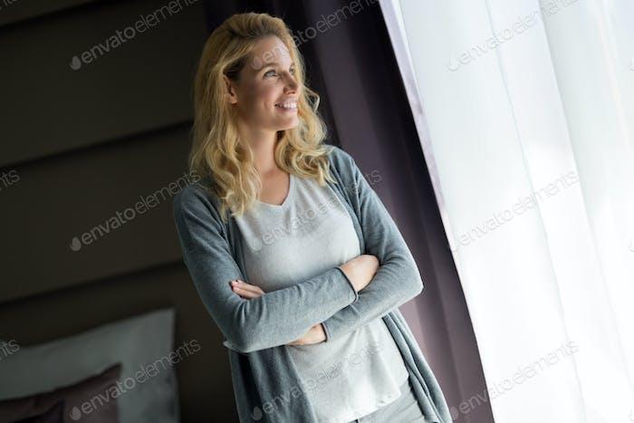 Portrait of attractive woman in hotel room