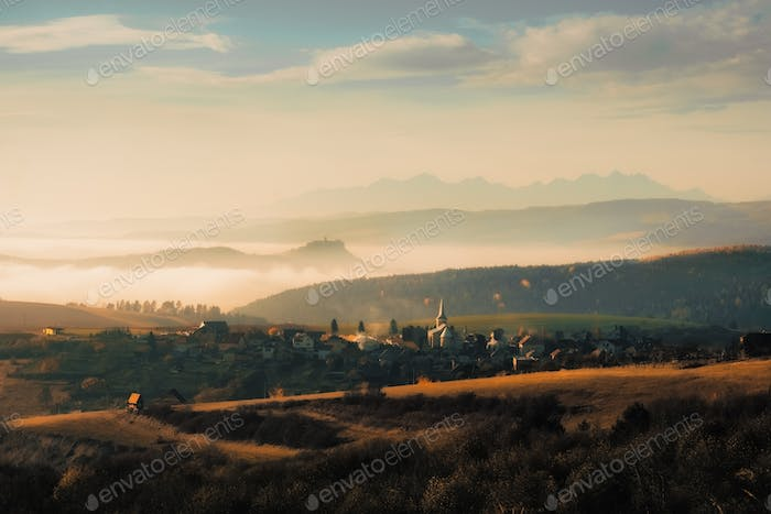 Landscape view of traditional village and Spissky hrad castle with High Tatras mountains, Slovakia