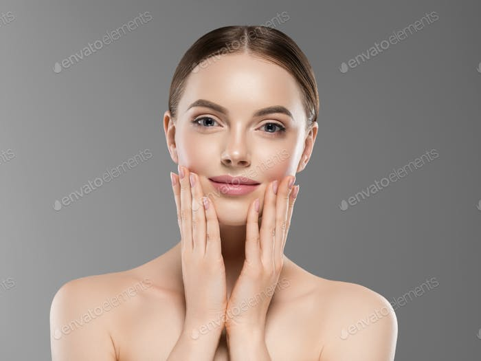 Beautiful face woman healthy skin gray background