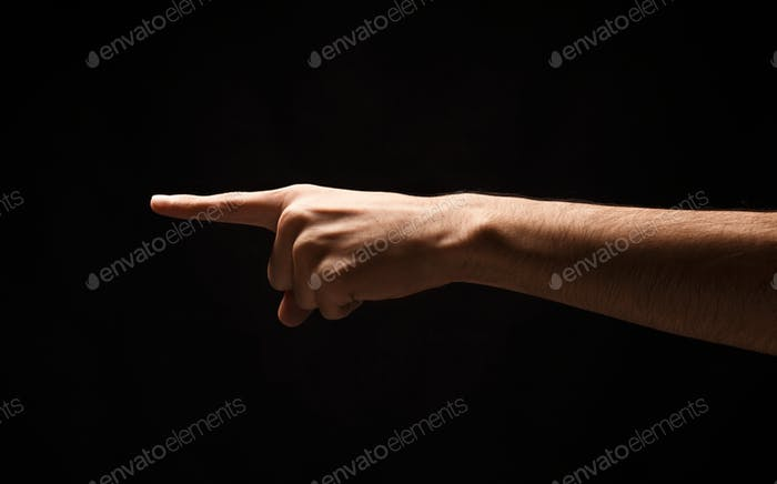 Hand gestures - man pointing, isolated at black
