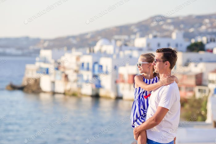 Father and little girl background Little Venice in Mykonos
