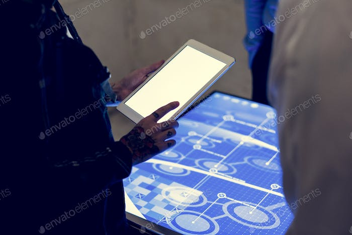 Hands holding using tablet at technology meeting