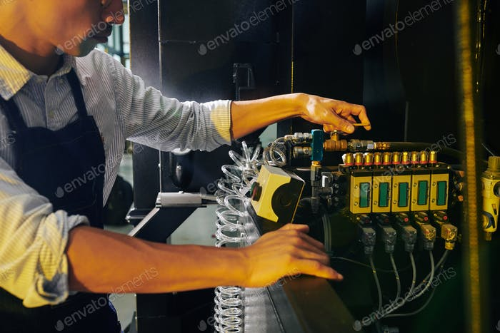 Manufacture worker turning on facility