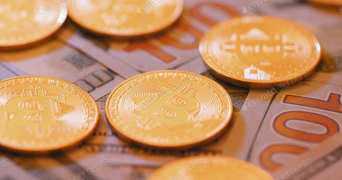 Bitcoin and US dollar paper banknote