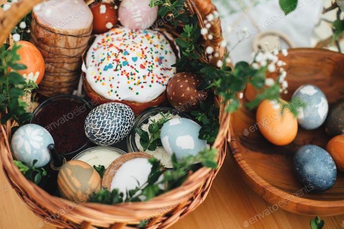 Easter modern eggs, easter bread, ham, beets, butter, in wicker basket