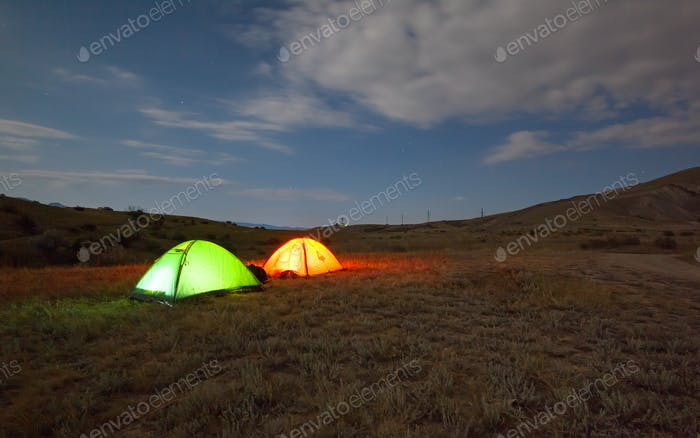 Green and red tent under the night sky