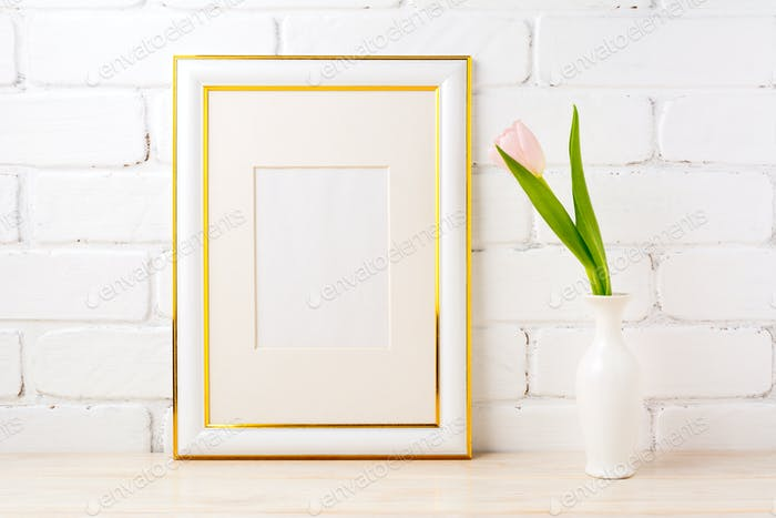 Gold decorated frame mockup with pale pink tulip in vase