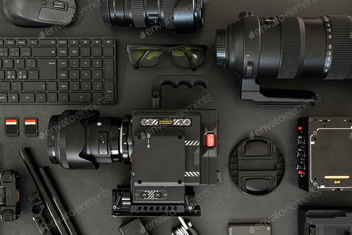 Top View of a Creative Filmmakers Office Desk with Lined up Camera and Gear