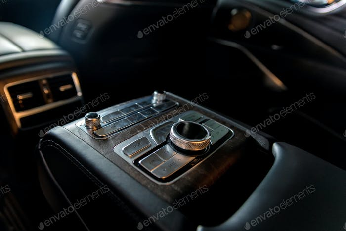 Modern luxury car central console for rear passengers