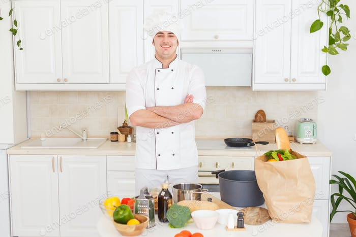 Smiling chef cooking vegetarian healthy meal
