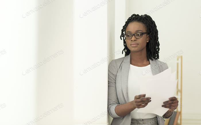 Secretary Girl Holding Papers Standing In Doorway In Office