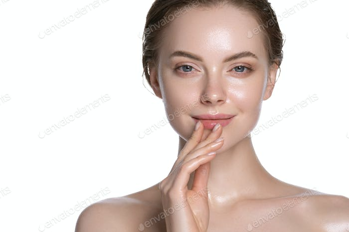 Natural girl healthy hydration clean skin face beautiful model neck shoulders. Isolated white.