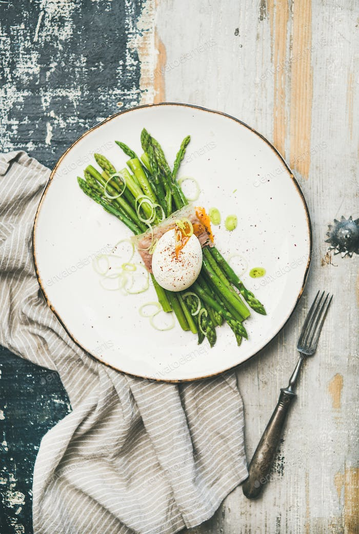 Healthy breakfast with green asparagus, soft-boiled egg , bacon