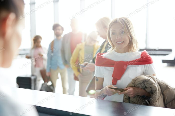 Passengers by check-in counter