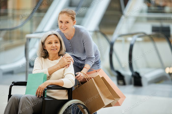 Daughter with disabled mother going for shopping
