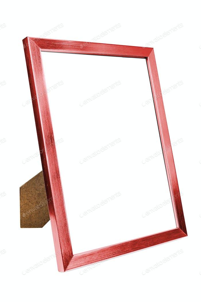 Leerer Bilderrahmen aus rotem Aluminium auf weißem Hintergrund
