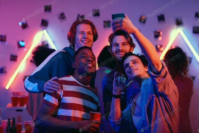 Boys making selfie portrait at party