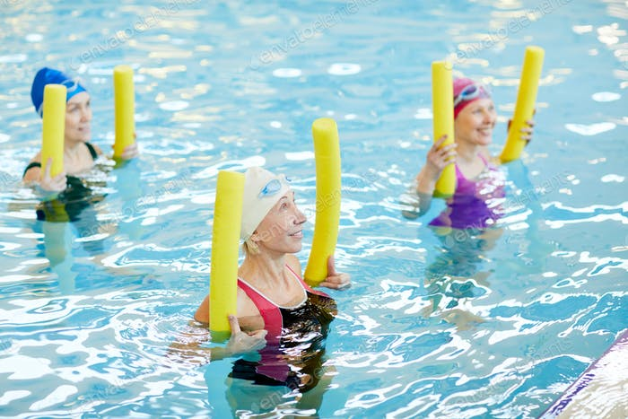 Mature Women Working Out in Water