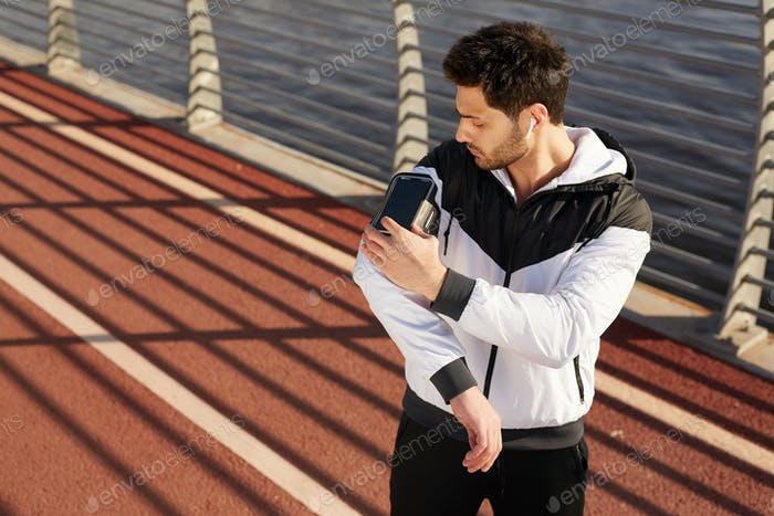 Sportsman with smartphone