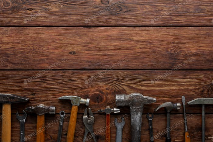 Border of repair tools on wood background with copy space