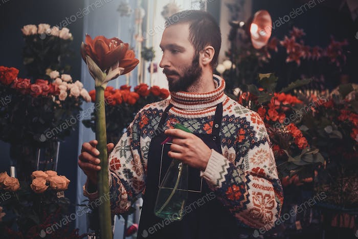 Portrait of attractive florist with flower