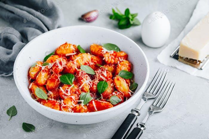 Traditional Italian potato Gnocchi with tomato sauce, parmesan cheese and fresh basil