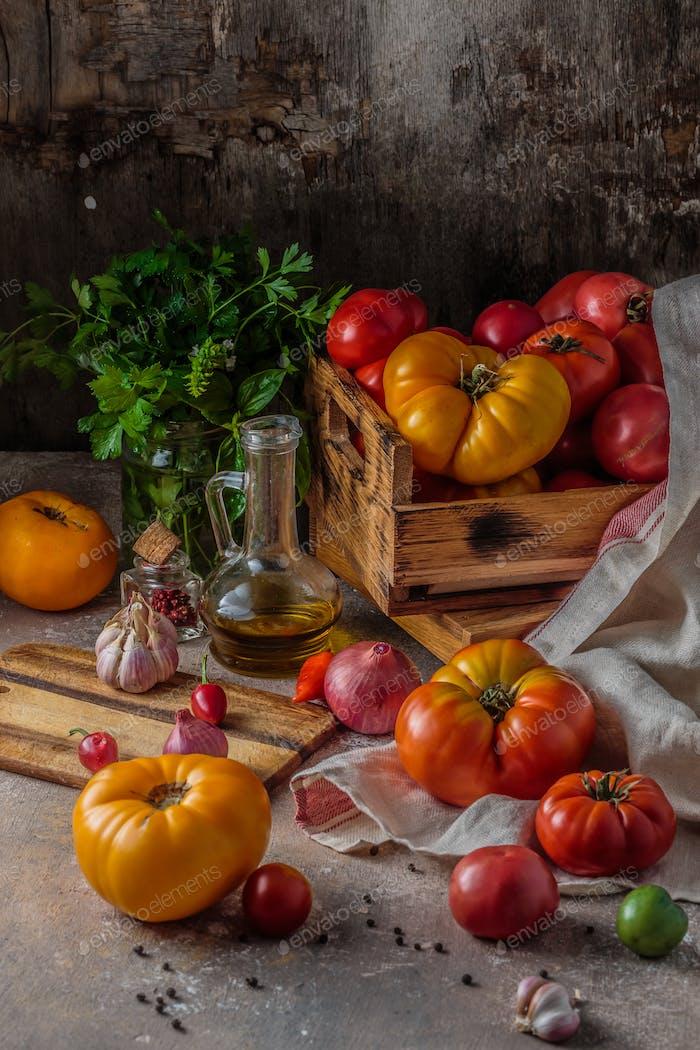 Heirloom tomatoes on dark rustic table, copy space