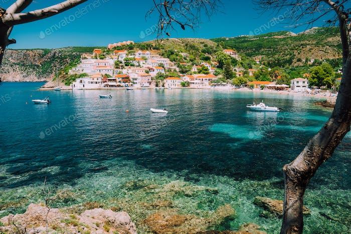 Assos village, Kefalonia Greece. View on turquoise transparent bay lagoon of Mediterranean sea