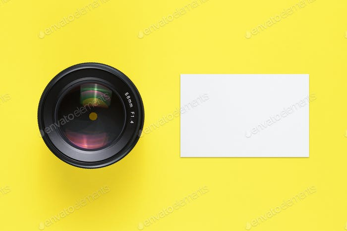 Business card mock-up and camera lens top view