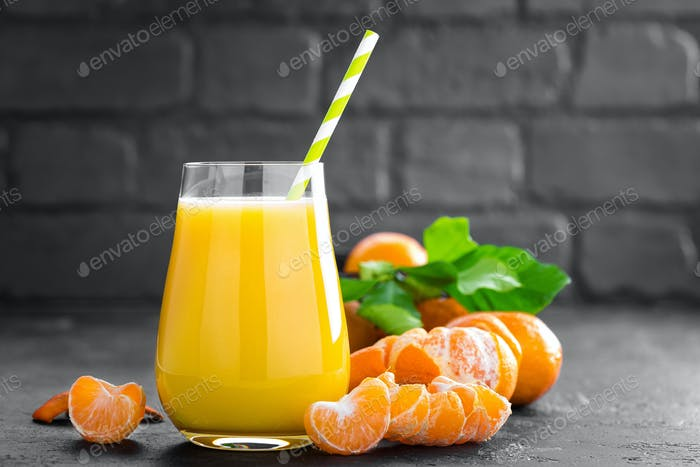 Tangerines, peeled tangerines and tangerine juice in glass