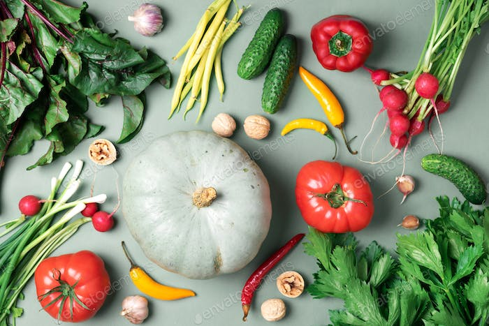 Autumn vegetables on green background. Top view. Vegan and vegetarian diet, harvest concept