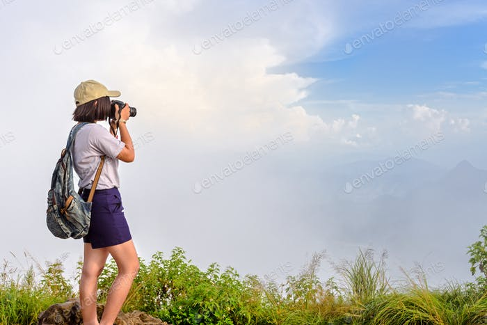 Hiker teens girl taking picture