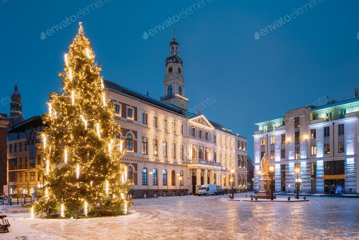 Riga, Latvia. Xmas Christmas Tree In Town Hall Square At Evening