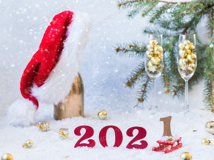 New Year's festive card with numbers 2021.Composition Champagne bottle in Santa Claus hat