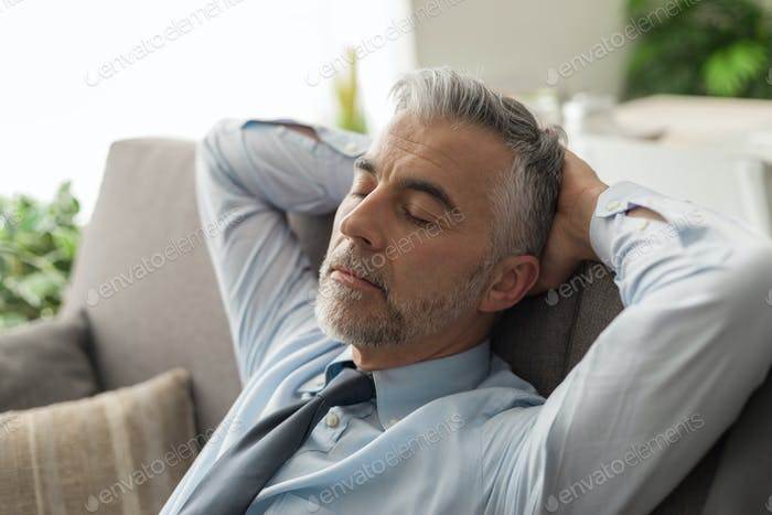 Businessman sleeping on the couch