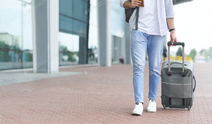 Man walking to airport with luggage, going on board
