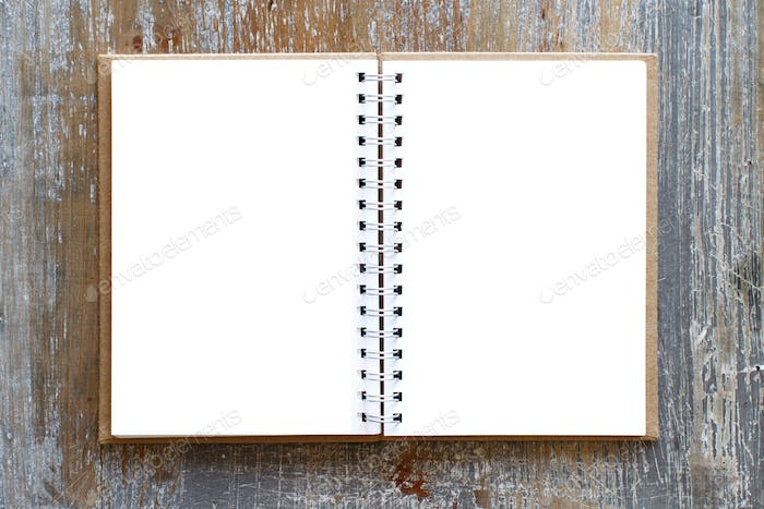 Blank opened notebook on a wooden table
