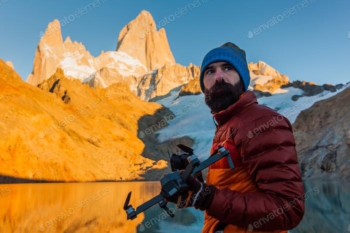 Tourist with drone on a background of mountain landscape. Patagonia