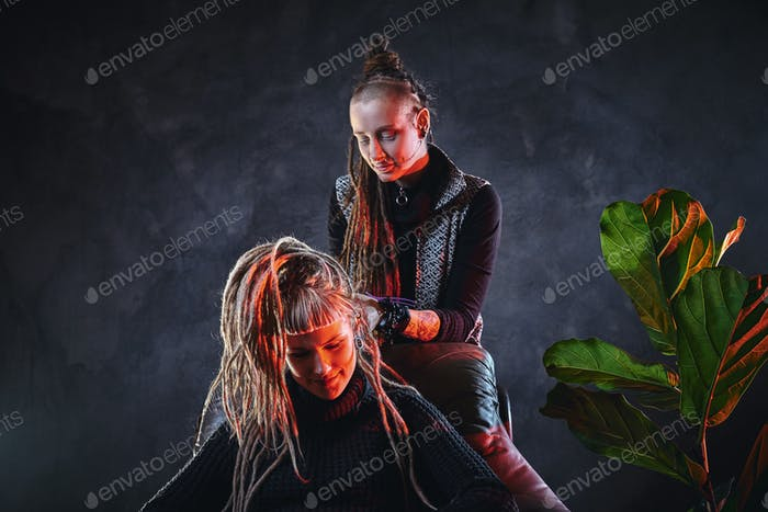 Talented master is making dreadlocks for a girl