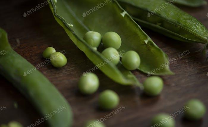 Close up of a green pea pod food photography recipe idea