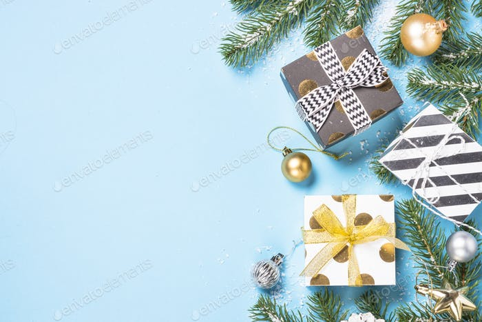 Christmas flatlay background - present box and decorations on bl