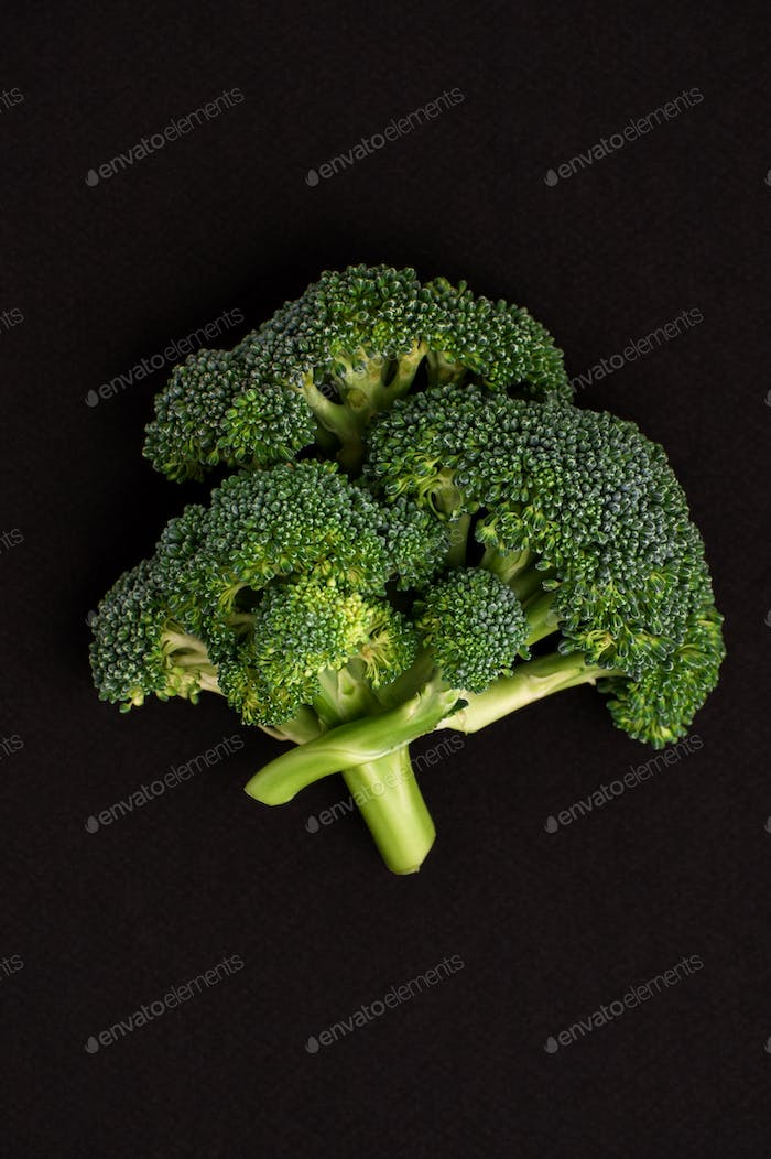 Broccoli cabbage on a black textural background.