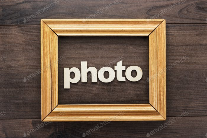 Wooden Frame With Word Photo On Table