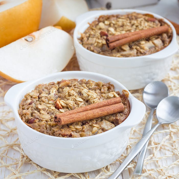 Baked oatmeal with nuts, almond milk, honey, spices and asian pear, square
