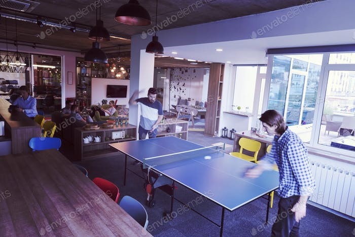 playing ping pong tennis at creative office space