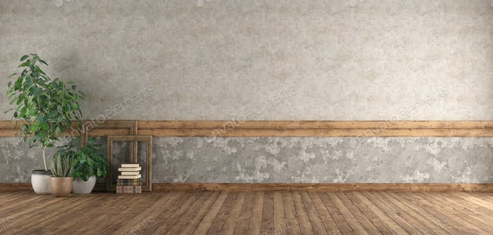 Empty room with wooden floor and old wall