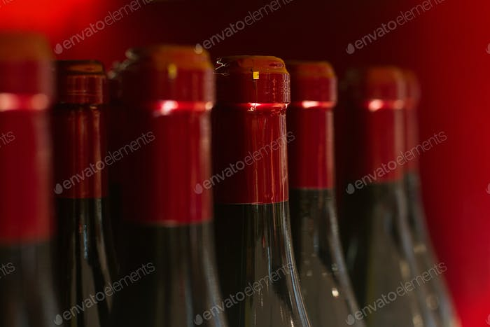 red wine bottles in store